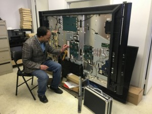 Oakville TV Repair technician repairing TV at Shop