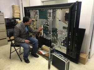 Oakville TV Repair technician repairing TV at Shop